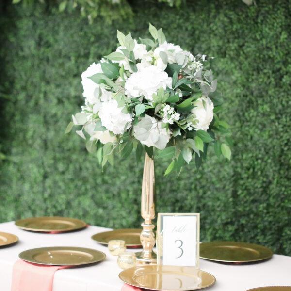 Tall centerpiece garden style wedding